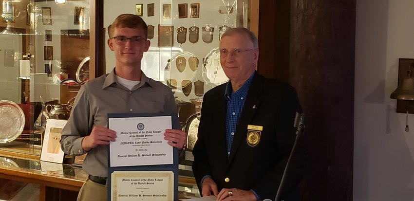 The Mobile Council Navy League presents the Rear Admiral William H. Stewart $1,000 Scholarship to Robertsdale High School NJROTC Cadet Darby Stevenson.