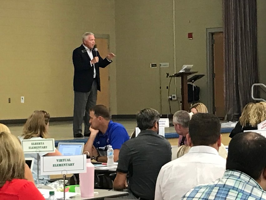 Eddie Tyler, Baldwin County superintendent of education, speaks to school system administrators at Fairhope Middle School on July 22. Tyler said schools will reopen Aug. 11 without mask requirements.