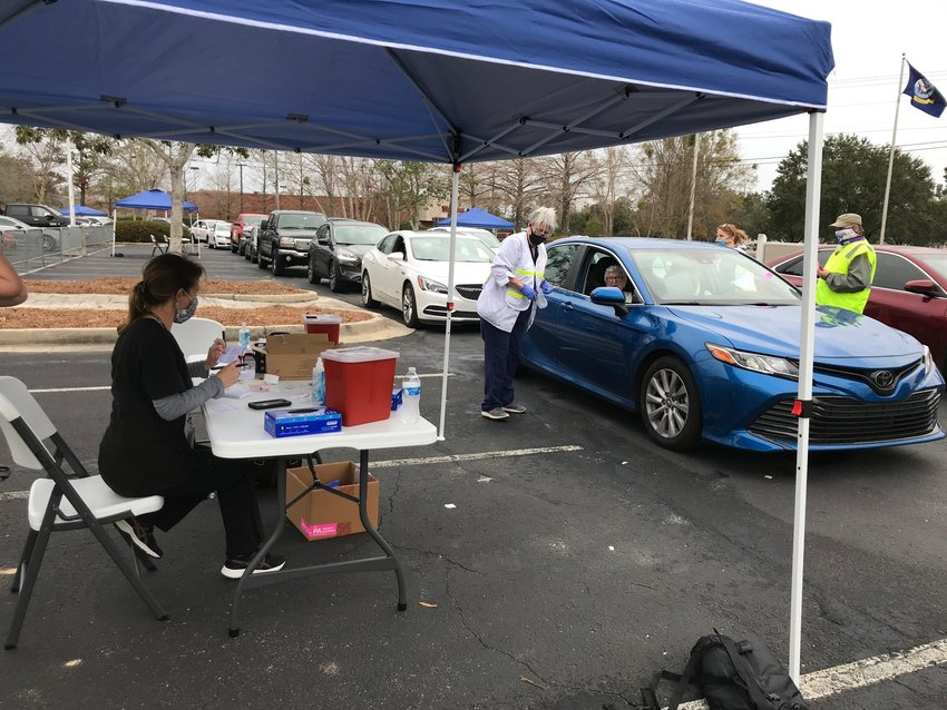 Baldwin County Department of Public Health and Emergency Management Agency officials conduct a vaccine clinic in Daphne in January 2021. The Baldwin County Commission voted in July to lift the COVID-19 state of emergency in place since March 2020.