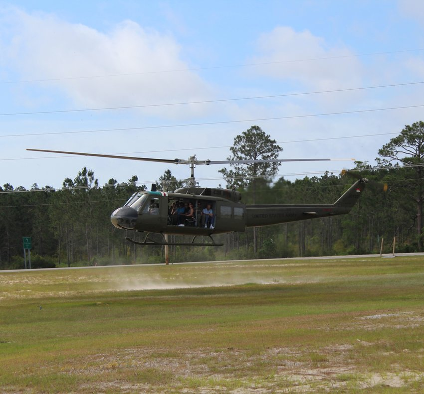 """Did you miss your chance to fly in an Army helicopter in June? You are in luck. The Friends of Army Aviation return to Orange Beach Aug. 18 – 19 with a UH-1H Iroquois, commonly known as the """"Huey."""""""