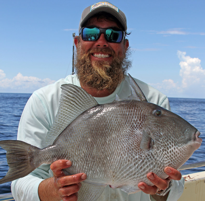 Richard Rutland shows off a big gray triggerfish hooked in the Alabama artificial reef zone.