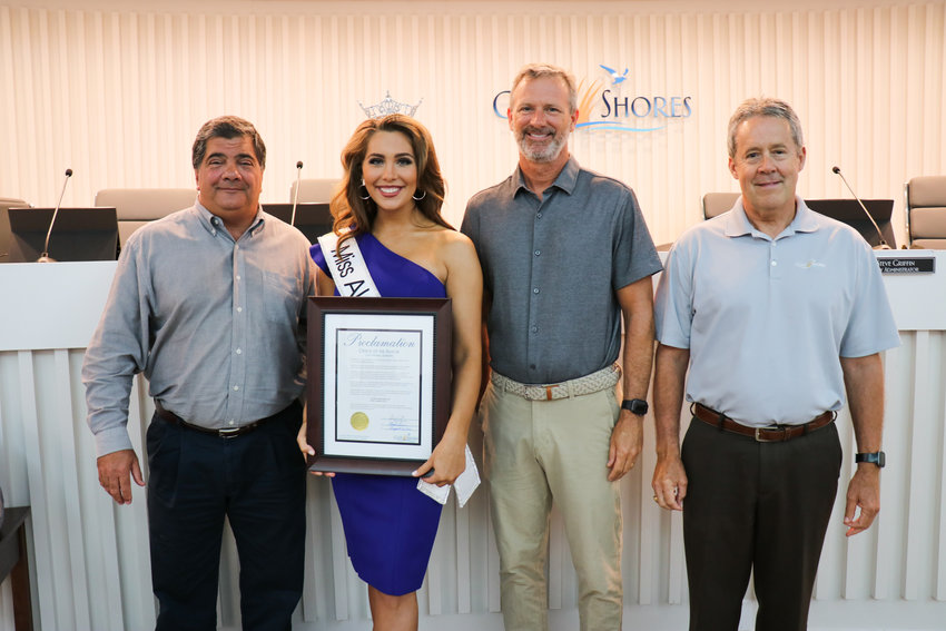 (From left) Mayor Pro Tempore Phillip Harris, Lauren Bradford, Councilman Jason Dyken and City Administrator Steve Griffin presented Bradford with a Proclamation from the Office of the Mayor of Gulf Shores proclaiming Monday, Aug. 2 2021 as Lauren Bradford Day.