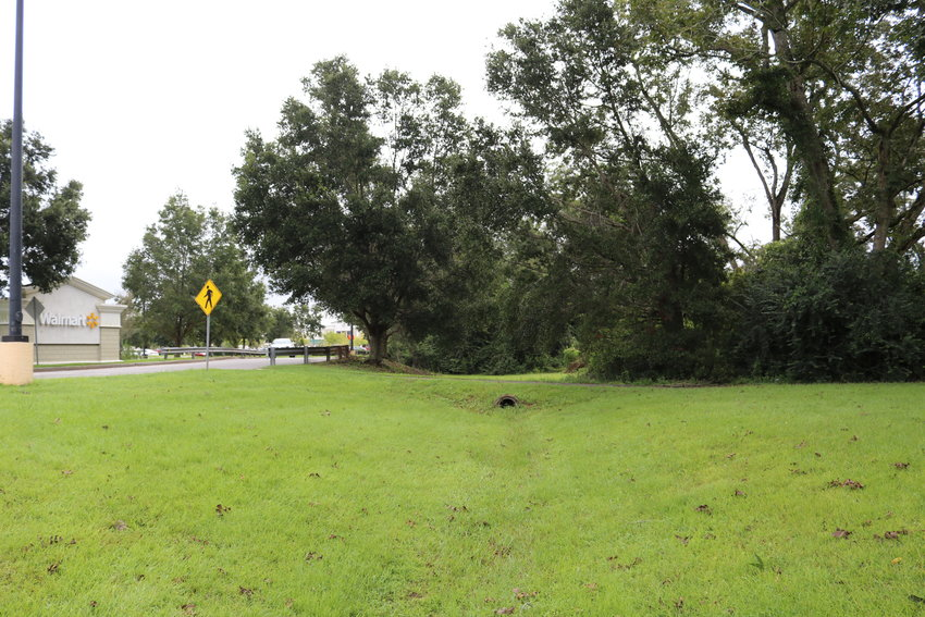 The city of Fairhope has acquired 12 acres of property next to the Walmart center at the intersection of Alabama 181 and Baldwin County 48. The city will build a police precinct on part of the property under the terms of the agreement.