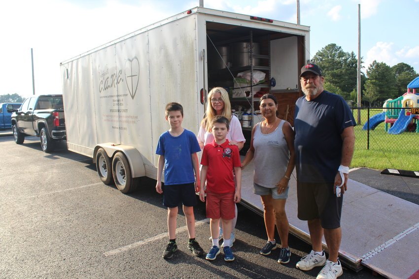 Volunteers with the First Baptist Church of Robertsdale prepare trailers Thursday, Sept. 2 ready to provide relief for Louisiana residents impacted by Hurricane Ida.