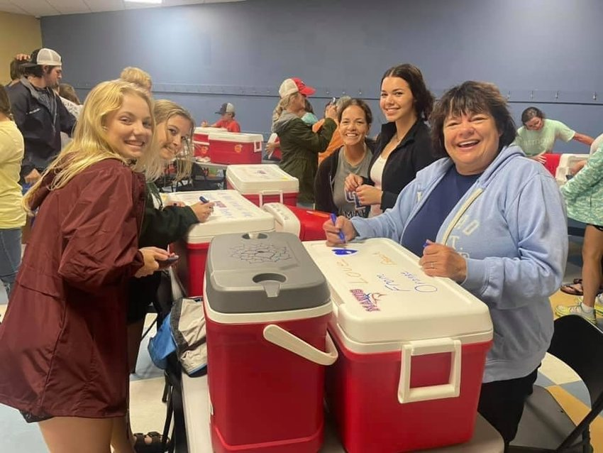 Residents young and old arrived at the Orange Beach Recreation Center Tuesday, Aug. 31 to decorate the coolers with art and inspirational messages and loaded them with drinks and needed supplies.