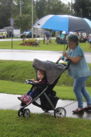 This young festival goer found a way to stay dry while browsing arts and crafts booths during the 36th Annual Heritage Day Festival held Saturday, Sept. 18 in Silverhill.