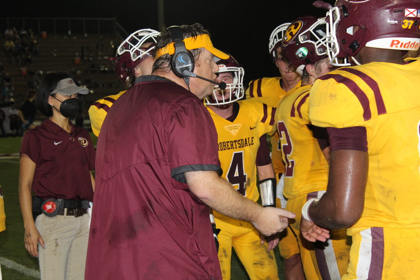 Robertsdale Golden Bear head coach Kyle Stanford tries to rally his troops on Homecoming night against 6A Region 1 rival Gulf Shores, but the Dolphins prevailed 27-13.