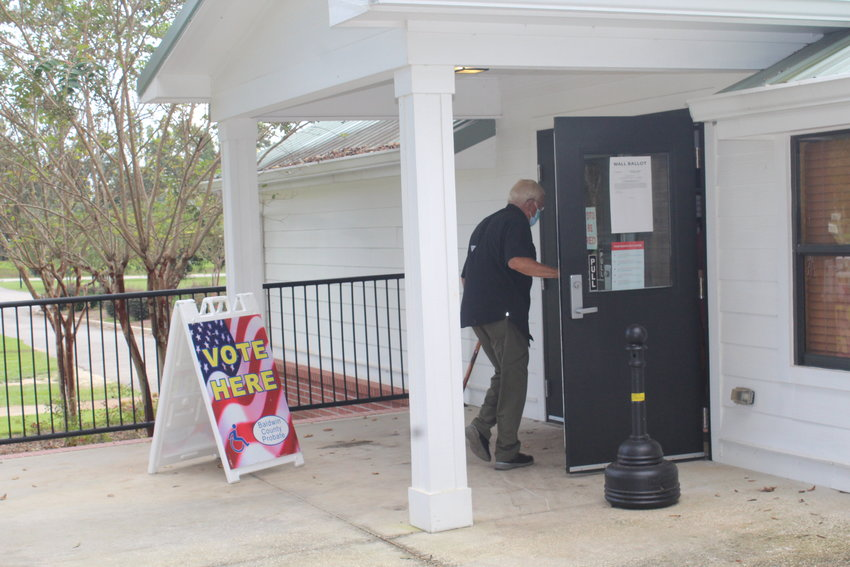 Voters in Robertsdale trickle into the PZK Hall to decide on the 3-mil tax for local schools on Tuesday, Sept. 21. Preliminary totals show less than 8 percent of eligible voters cast their ballots on Tuesday with the tax passing by a narrow margin.
