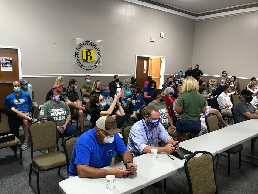 Parents take part in a school board meeting Aug. 19 on mask requirements in Baldwin schools. Many parents at the meeting objected to the requirement. Masks will be optional in Baldwin schools starting Monday, Sept. 27.