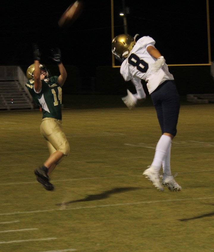 Sophomore Corbin Hall goes up for a pass for Snook Christian Academy Friday night at John T. Cobb Stadium in Elberta.