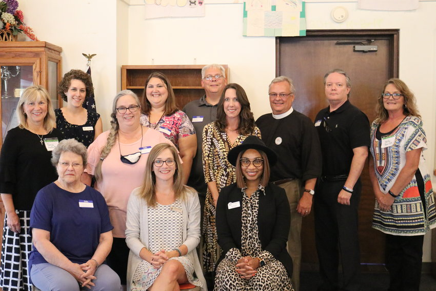 Pictured here, back row, from left: Foley Woman's Club member Tanya Blair, Dana Jepsen with Ecumenical Ministries, Tammy Kinney with the Baldwin County Heritage Museum, Emily Thompson with Foley Middle School/Project REACH, Larry Lewey with Baldwin County Sheriff's Boys Ranch, Jessica Ware with Baldwin County CARE House, Pastor Brent Norris with St. Paul's Episcopal Church, John Jackson with Foley Public Library, and Foley Woman's Club President Kelly Barrett.  Front row, from left: June Taylor, Chairwoman of the Baldwin County Heritage Museum Board, Megan Melvin with Jennifer Claire Moore Foundation, and Joy Lymon with Foley Boys & Girls Club.