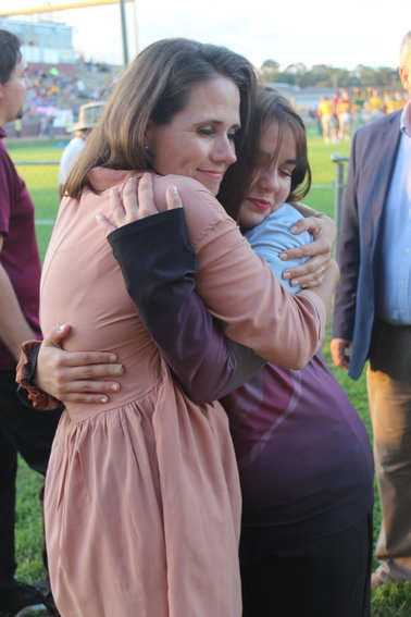 """Elsanor Elementary School teacher Christie Lyles gets a hug from RHS senior Nicole Lawrence, who nominated her as a """"Teacher Who Inspired Me"""" for 2021-22."""