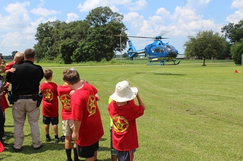 Campers watch as the Air Methods (Baptist Hospital) Life Flight helicopter lands at Central Baldwin Middle School.