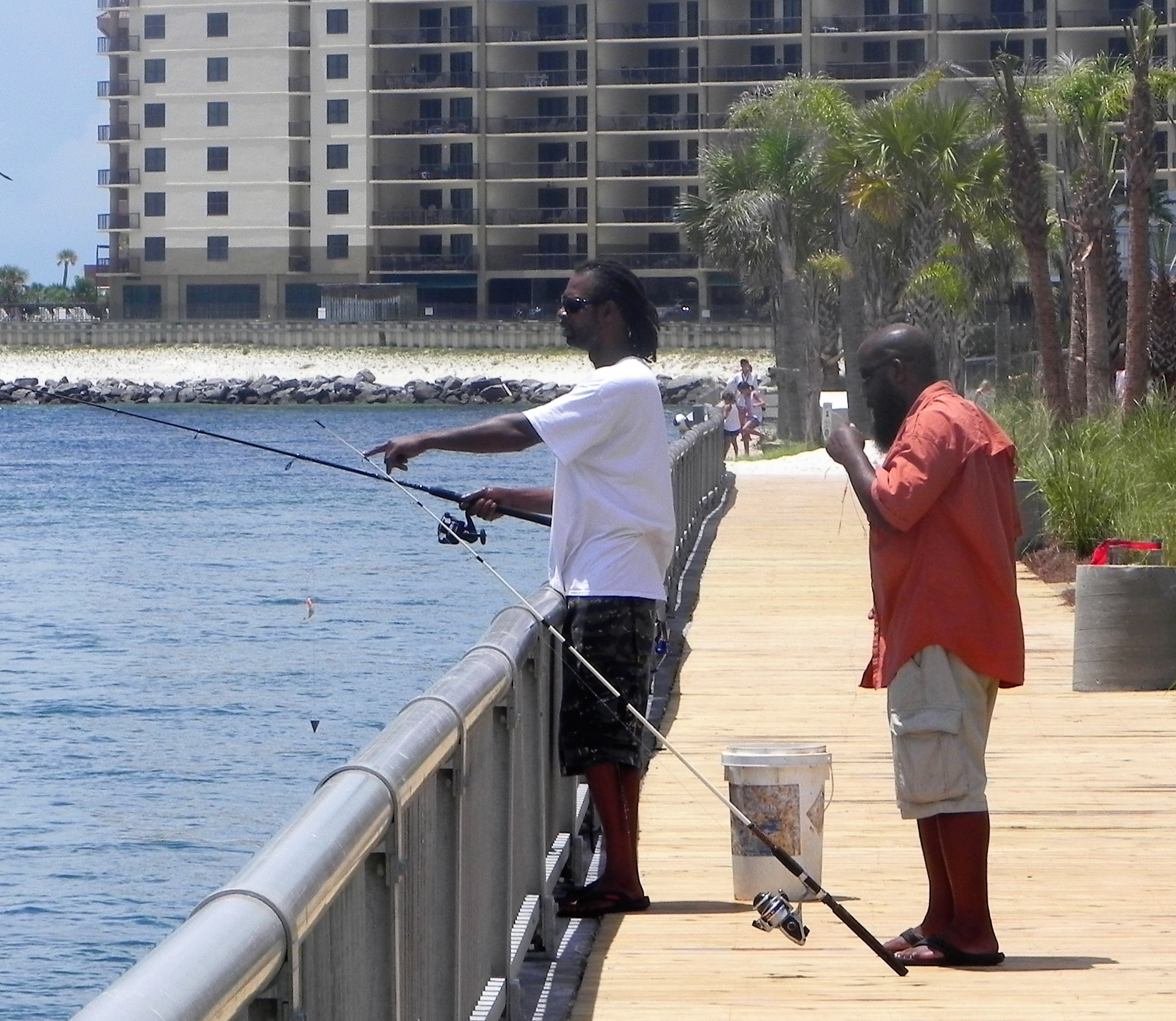 Gerome Johnson and Quinton Parrish of Foley fishing at Perdido Pass.