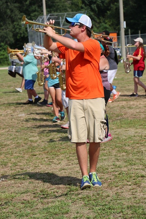Austin Hutchinson plays the trumpet during band camp.