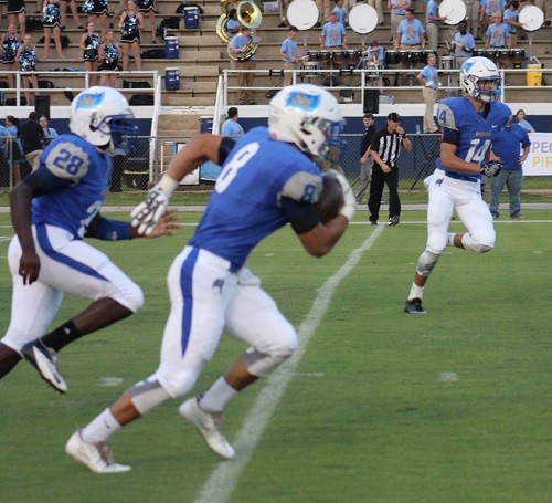 John Sherill (8), returns a kickoff flanked by Tanner Deeds (14) and Darnell Bell (28).