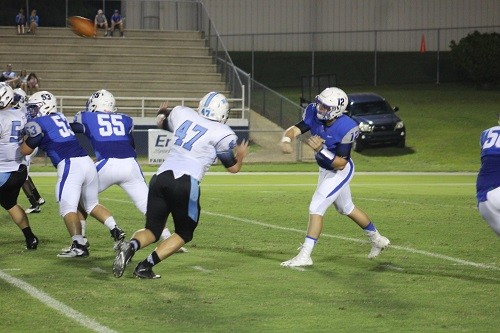 Dylan Casstevens with the pass, blocking by Kane Reedy (53) and Mitchell Chambers (55).