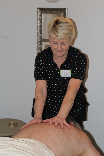 Licensed massage therapist Jeanne Blake works on a client at All About You Massage.