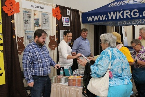 Gulf Coast Media staff man the booth at the Baldwin County Senior Expo on Oct. 6.