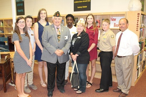 Vice Principal Teddy Mitchell and members of the Freshman Advisory Council at Robertsdale High School welcomed special guests Wayne and Donna Stacey to a Veterans Day observance at Robertsdale High School Nov. 4. Pictured are, from left, Sarah Shipp, Jacob Eakin, Blakeley Laird, Travis McGowan, Holly Wilson and Peyton Goodwin.