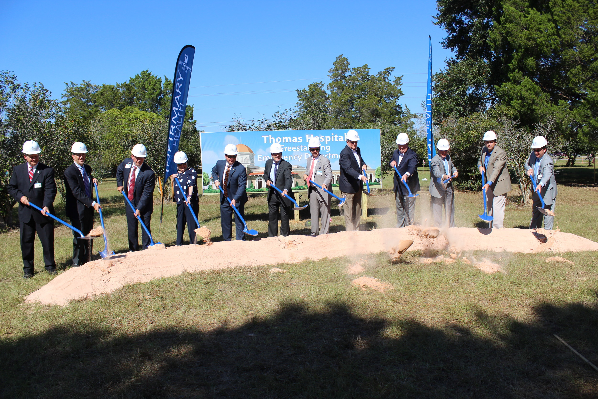 Thomas Hospital and Infirmary Health leaders, local elected officials and others help celebrate the groundbreaking ceremony for the coming freestanding emergency facility in Malbis last week.