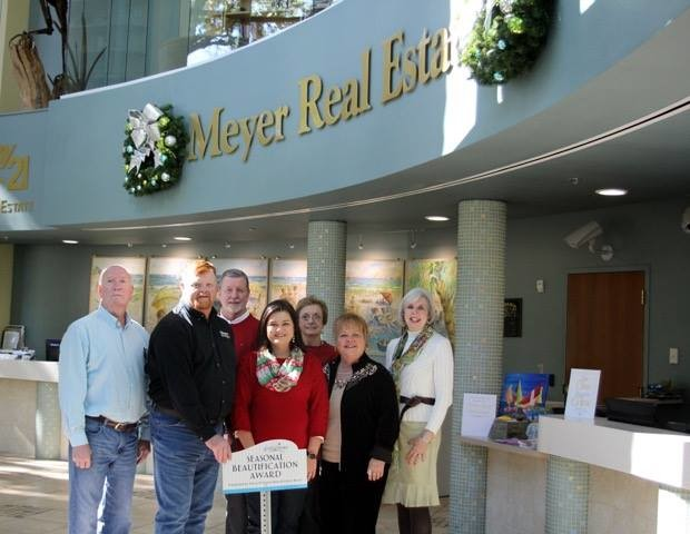 The Gulf Shores Beautification Board awarded Meyer Vacation Rentals its inaugural Beautification Award for a seasonal display. From left, those pictured are Rodney Powell, Gulf Shores Beautification Board; Tom Flowers, Meyer Vacation Rentals facilities and fleet coordinator; Gene Barnett, Meyer Vacation Rentals vice president of operations; Michelle Nelson, Meyer Vacation Rentals president; Mary Wayne Gilmore, Gulf Shores Beautification Board; Sheila Hodges, Meyer Vacation Rentals owner and chairman of the board; and Sarah Kuzma, Meyer Vacation Rentals operations specialist.