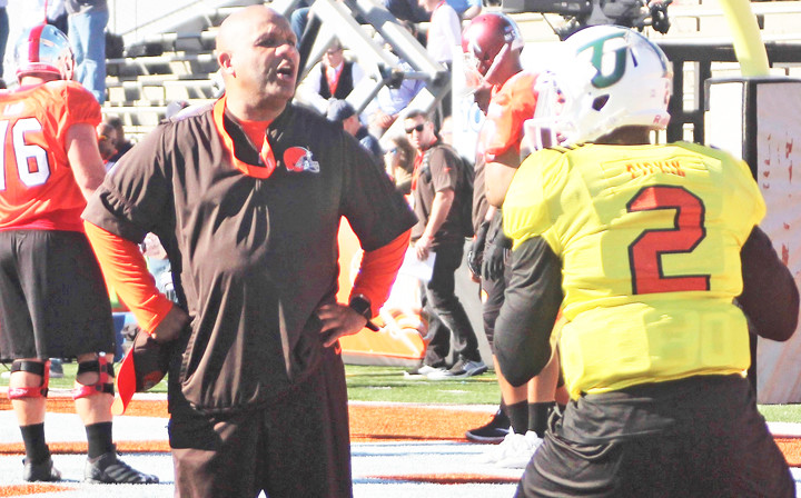 Cleveland Browns head coach Hue Jackson and Tiffin QB Antonio Pipkin go through some drills.