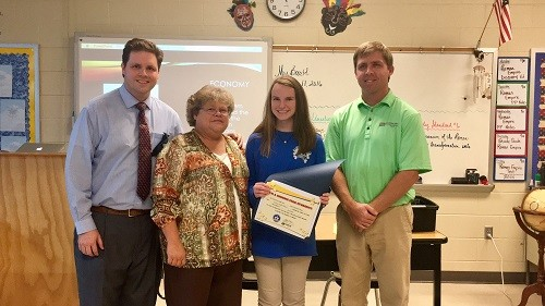 Pictured, from left, WALA Fox 10 TV's meteorologist Michael White, Fairhope Middle School faculty member Karen Bartl and Baldwin EMC Energy Marketing Specialist Kevin Wilson congratulate Fairhope Middle School student Laney Haas on her Shining Star Student award.