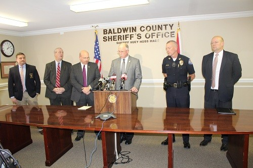 "Baldwin County District Attorney Bob Wilters and Sheriff Huey ""Hoss"" Mack Jr., along with members of the Baldwin County Major Crimes Unit, hold a press briefing Thursday at the Baldwin County Sheriff's Office in Bay Minette."