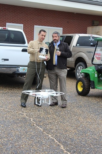 Lt. Col. Scott Meehan, senior naval science instructor for the Robertsdale High School Jr. Naval ROTC program, demonstrates the use of the school's drone for Principal Joe Roh.