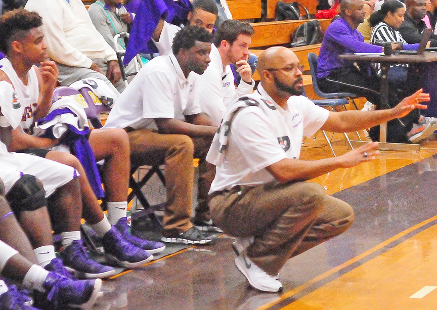 Men at work: Daphne head coach Cedric Yelding conducting second-half action with coaches DeJuan Jackson and Bruce Gilliland.