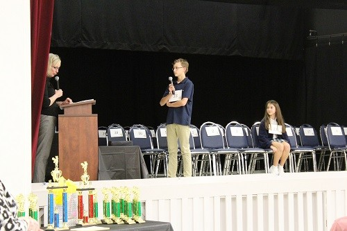 Fletcher Ard closes out the 2017 Spelling Bee with pronouncer Dr. Joyce Woodburn, academic dean for Baldwin County Public Schools, giving him the final word of the competition, as runner up Kate Ginger of Bayside Academy looks on.