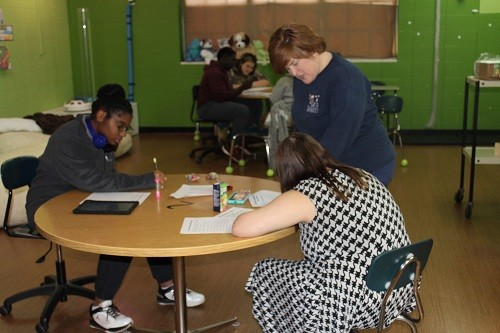 Coordinator Angela Hodges works with students on YAP training as part of the Project BEAR program at RHS.