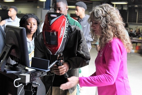 Kim Kortman, account manager with Wesco Gas & Welding Supply Co. demonstrates a virtual welder during Career Day at the Maritime Training Center in Mobile on Tuesday, March 7. More than 350 students from Mobile and Baldwin counties were expected to attend the event.