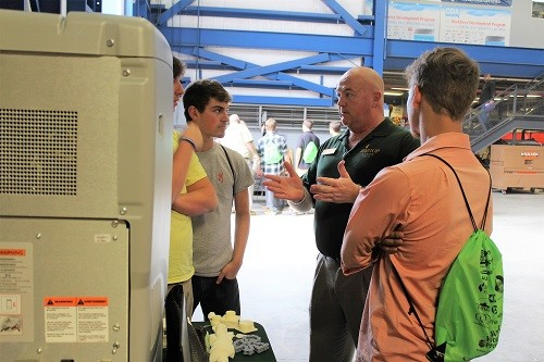 Instructor Michael Higginbotham from Bishop State Community College demonstrates the school's 3D printer.