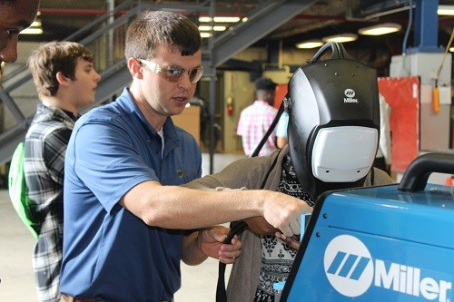 Ryan O'Dell, district manager for Alabama, Mississippi and Florida, with Miller Electric Manufacturing Co., conducts a virtual welding demonstration.