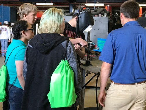 Students from South Baldwin Center for Technology gather around a virtual welding machine at Tuesday's career day at the AIDT Maritime Training Center in Mobile. Nearly 300 students from Mobile and Baldwin counties attended the event.