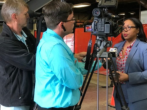 Mobile TV reporters interview Jacquie Allen, manager of communications for AIDT, at a career day for high school students from Mobile and Baldwin counties. Nearly 300 students attended the event Tuesday, March 7.