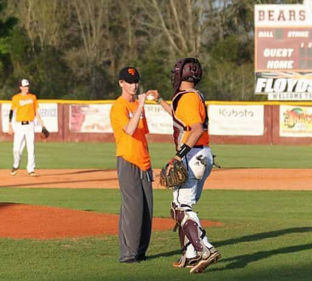 Robertsdale catcher Evan Robertson gives teammate Keaton Krebs the first-pitch ball Friday.