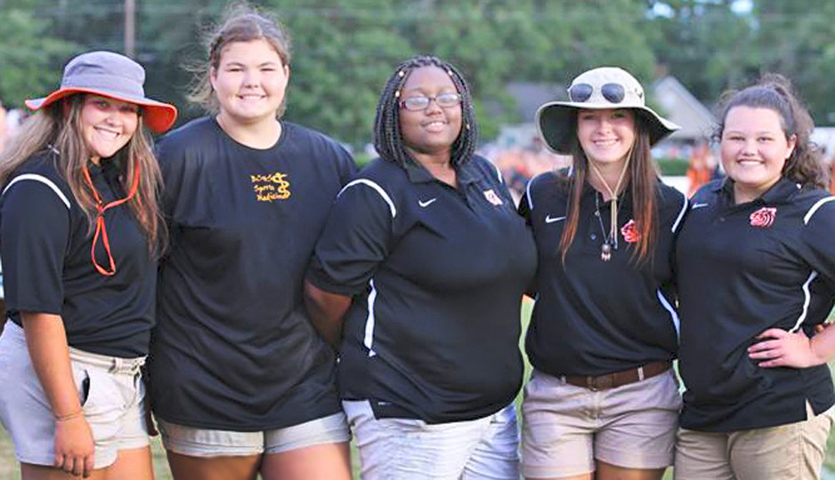 Numerous students have participated in the Student Aide program at Baldwin County High School. A few of those on the sideline are, from left, Nina Quezada, Grace Girby, Kayla Jones, Tristan Blackmon and Lindsay Howard.
