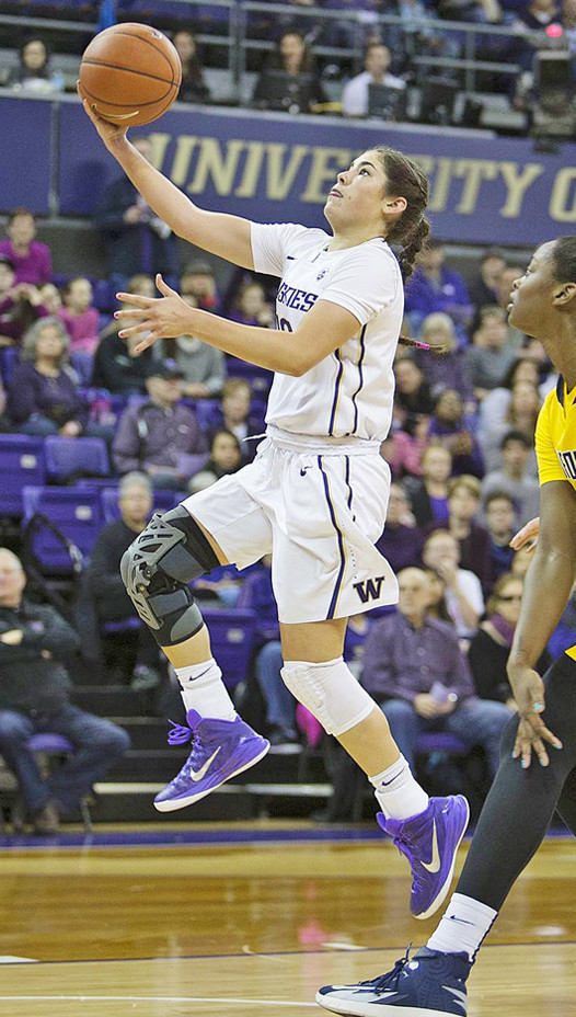Kelsey Plum takes one to the rim for the Huskies.