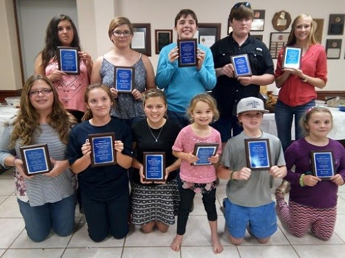 Young volunteers receive plaques for their community service. Pictured are, front row, from left,  Baleigh Collins, Maddison Pouncey, Sabrina Collins, Allyson Pouncey, Kyle Dunbar, Sharon Ellison; back row, from left, Erica Dicks, Grace Ellison, Samuel Collins, Cole Dunbar and Olivia Dugger.