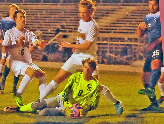 Morgan Lollar gets to the ball off a corner kick. The Dolphins keeper had five saves at Daphne.