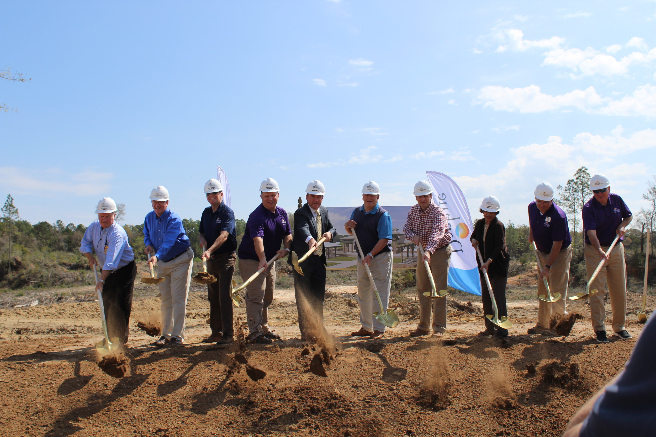 Members of the Daphne City Council, Mayor Dane Haygood and city staff throw the ceremonial first shovels of dirt at the city's new sports complex.