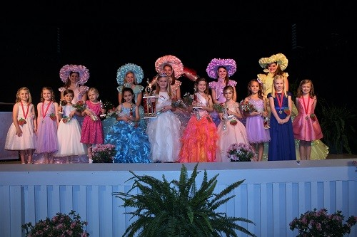 The 2017 Little Miss Strawberry Queen and her court pose with Dogwood Trail Maids.