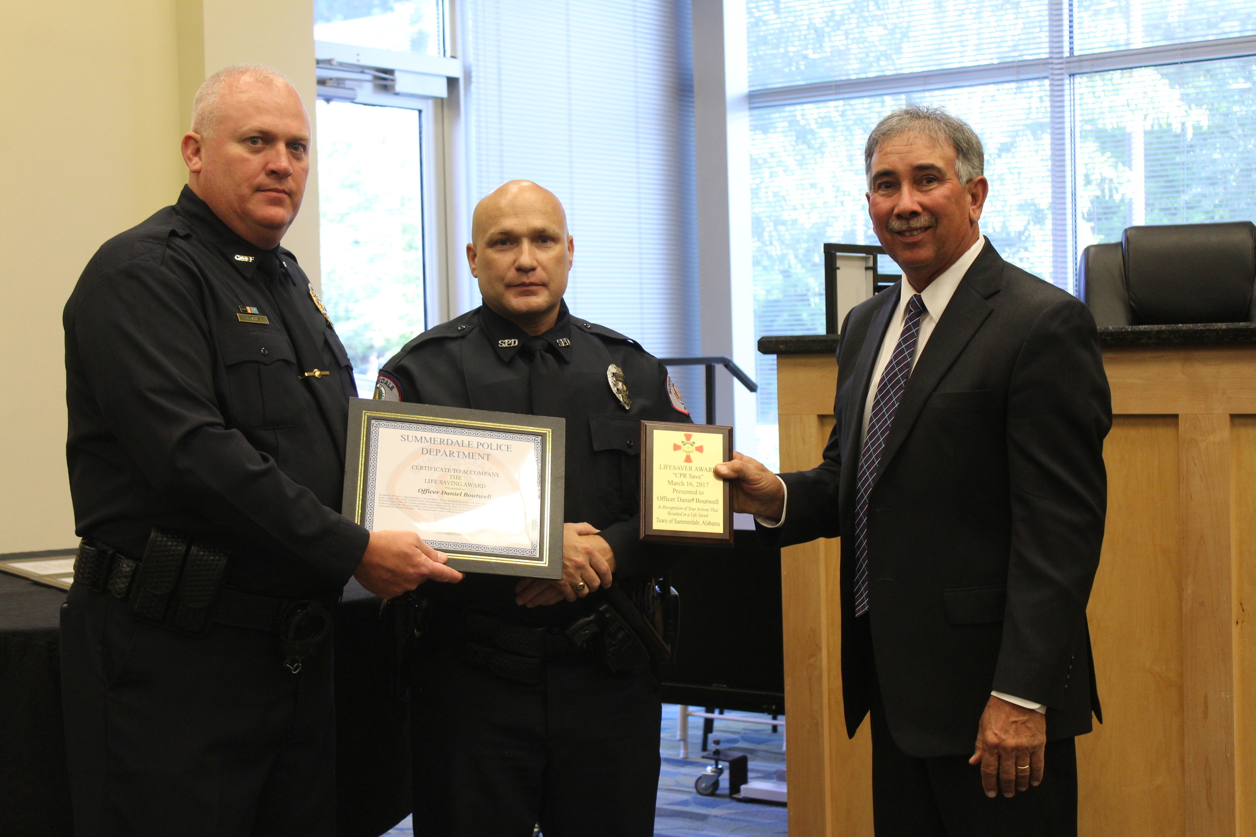 Officer Daniel Boutwell with the Summerdale Police Department received one of three lifesaving awards at the Summerdale Town Council meeting on April 10.