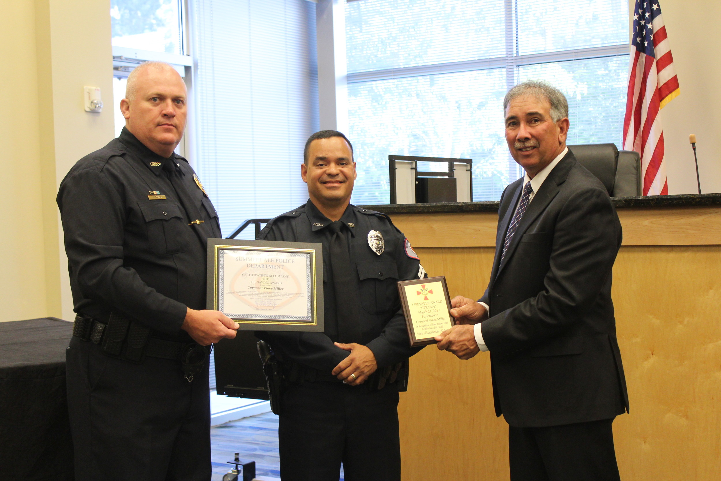 Cpl. Vince Miller with the Summerdale Police Department received one of three lifesaving awards at the Summerdale Town Council meeting on April 10.