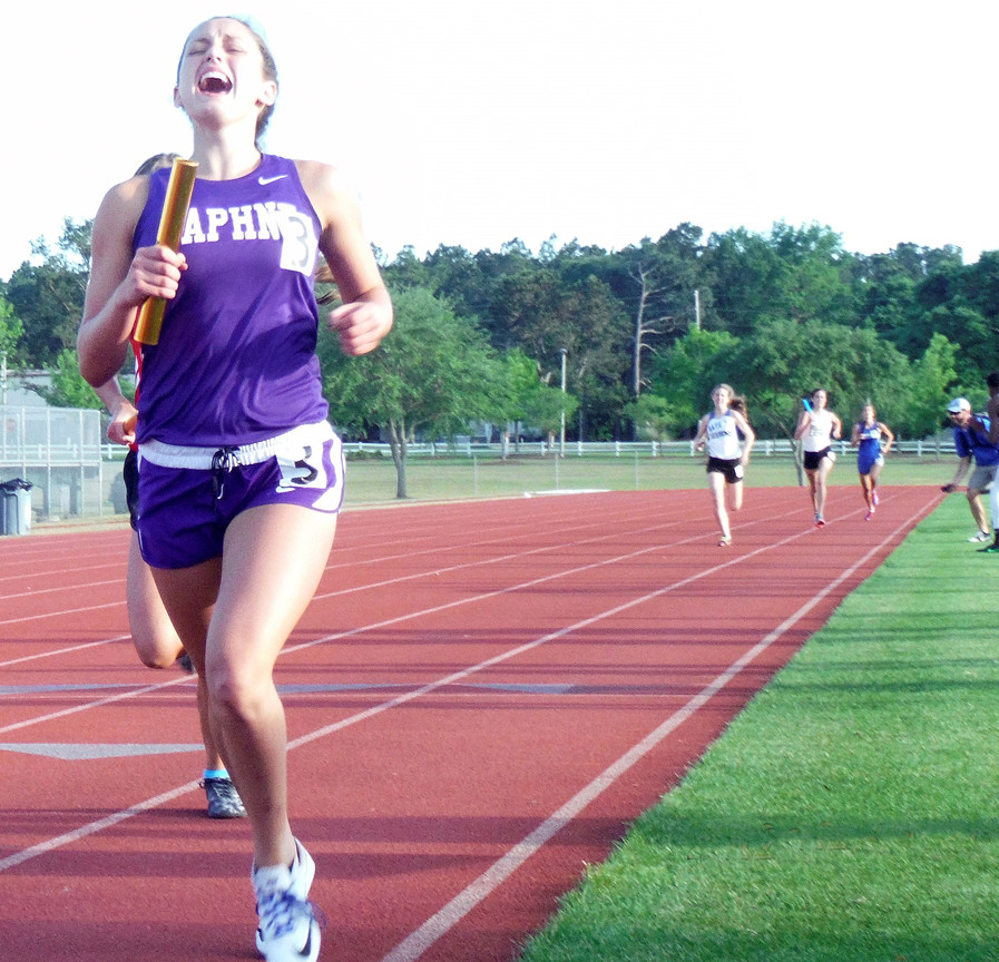 Shelby Sliman finishes the final leg for Daphne and a Trojans' win in the Girls 400-meter relay.