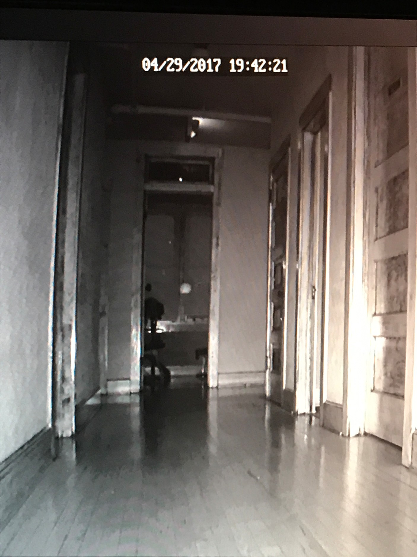 Thanks to the team's equipment, orbs were caught on film. The still above is one such orb that crossed the upstairs hallway from one room to the next.