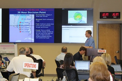 "Jason Beamon with the National Weather Service in Mobile gives an update on ""Hurricane Alex"" during the Tropical Event Exercise on Tuesday at the Baldwin County Emergency Management Agency's Emergency Operation Center in Robertsdale."